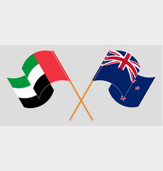 Crossed and waving flags new zealand vector