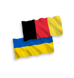 Flags of belgium and ukraine on a white background vector