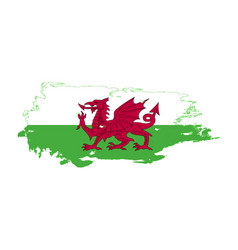 Grunge brush stroke with wales national flag vector