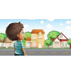 A young boy standing across the village vector