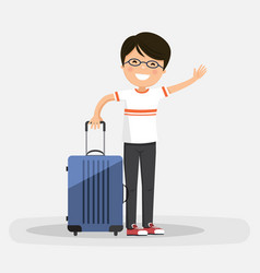 Isolated happy boy with blue suitcase on a white vector