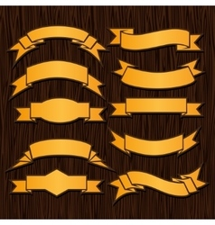 Gold retro ribbons and labels on wooden background vector image