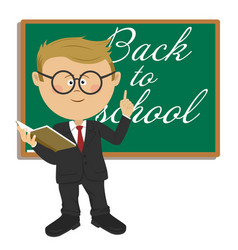 primary schoolboy standing next to blackboard vector image