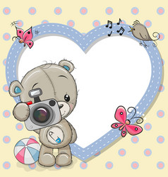 Cute teddy bear with a camera and a heart frame vector