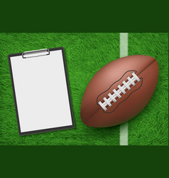 Rugby ball and clipboard on stadium green grass vector
