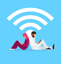 young muslim couple read using a tablet pc vector image