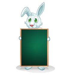 A bunny holding an empty board vector