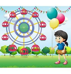A girl holding balloons at the carnival vector