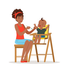 Happy young african mother feeding her baby in vector