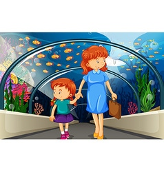 Mother and kid at the aquarium vector