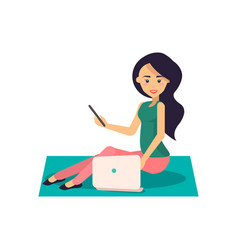 woman working with laptop and phone sits on floor vector image