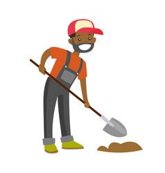 A happy black farmer with a shovel on a farm field vector