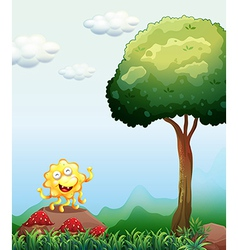 A happy monster above the rock near the mushrooms vector image
