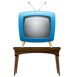 A blue television above wooden table vector