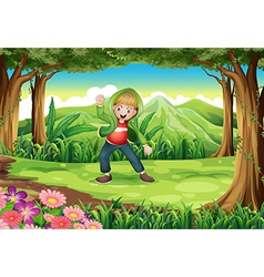 A jungle with a boy dancing vector image