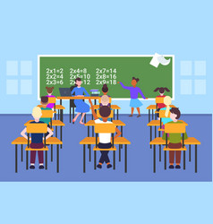 female teacher with pupils sitting at desks vector image