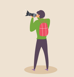 Guy photographs with a slr camera in a vector