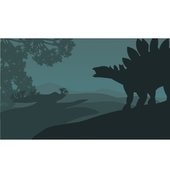 Single stegosaurus silhouette in hills vector