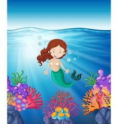 Mermaid swimming in the sea vector image