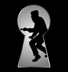 Silhouette of a thief seen through a keyhole vector