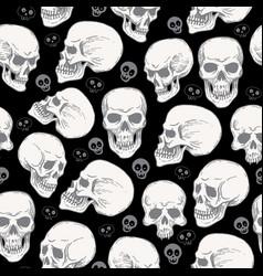 Seamless pattern with skulls on black blackground vector