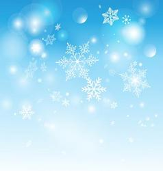 Beautiful shimmering snowflakes on a blue vector image vector image