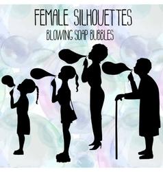 Female silhouettes blowing soap bubbles vector