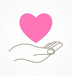 hand holding a heart shape symbol vector image
