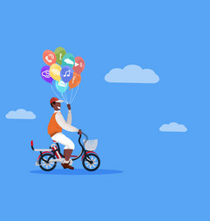 Man cycling bicycle holding colorful balloons vector