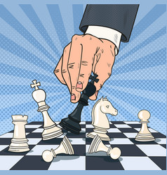 Pop art hand of businessman playing chess vector