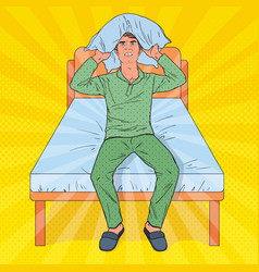 Pop art frustrated man closing ears with pillow vector