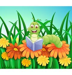 A worm reading book at the garden vector