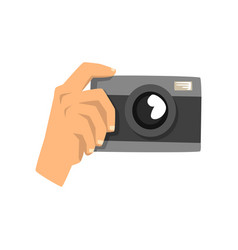 hand taking photo with camera vector image