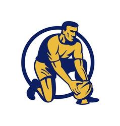 Rugby player kneeling preparing a goal kick vector