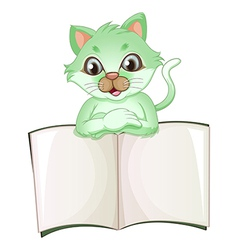 A cat holding an empty book vector image vector image