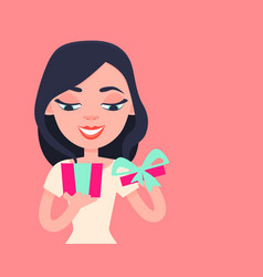 happy girl opening a gift vector image