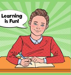 pop art smiling schoolboy doing homework vector image