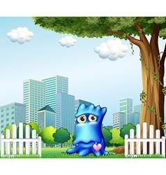 A blue monster standing near the fence across vector