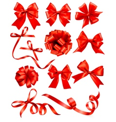 Big set of red gift bows with ribbons Stock vector