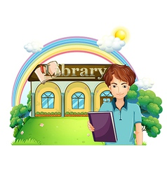 A boy holding a book standing in front of the vector image vector image