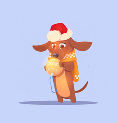 cute dog in santa holding christmas ball with 2018 vector image