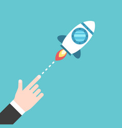 Hand launching space rocket vector