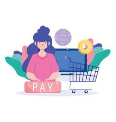 Online payment woman computer shopping cart world vector
