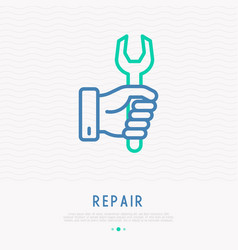 Hand holding wrench vector