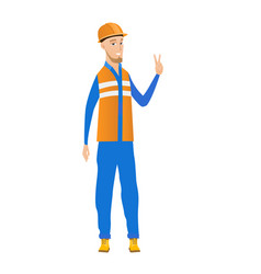 Young caucasian builder showing victory gesture vector