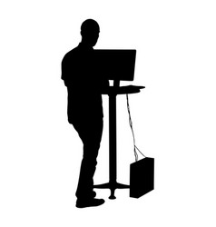Man standing and working on computer silhouette vector