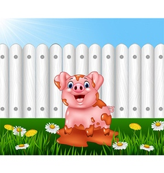 Cartoon funny pig playing in the mud vector image vector image