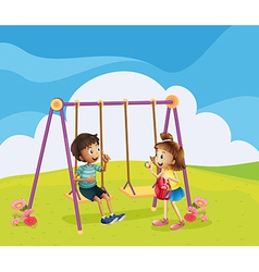 A boy and a girl at the playground vector image vector image