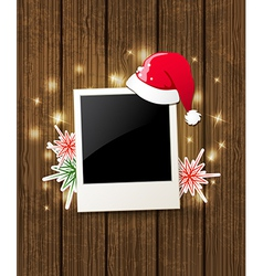 Christmas background with photo and santa hat vector