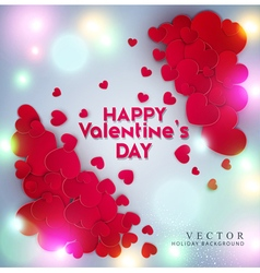 Red hearts on a bright luminous background vector image